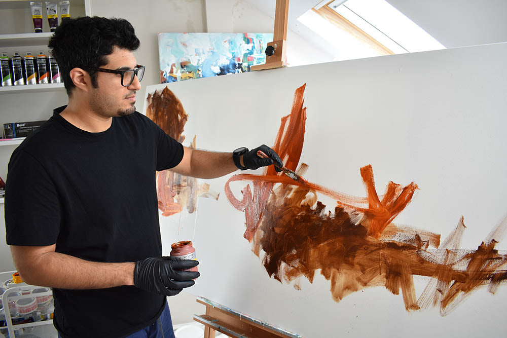Omar is working on a big canvas