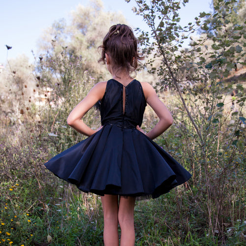 Black dress with feathers, glass beads & crystal.