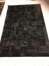 Soft black cowhide area rug