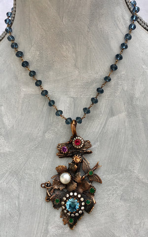 OOAK Turkish Collage Necklace in Bronze with Bird, Leaves, Blue Topaz, Emerald, Pearl, Citrine, Amethyst, Ruby, Topaz, on an Iolite Wire Wrapped Strand, with Serpent Clasp