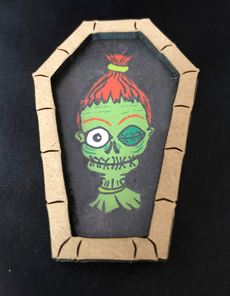 Shrunken Head Brooch