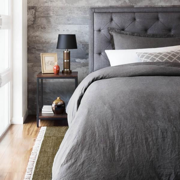 Bed with Linen Duvet and a nightstand