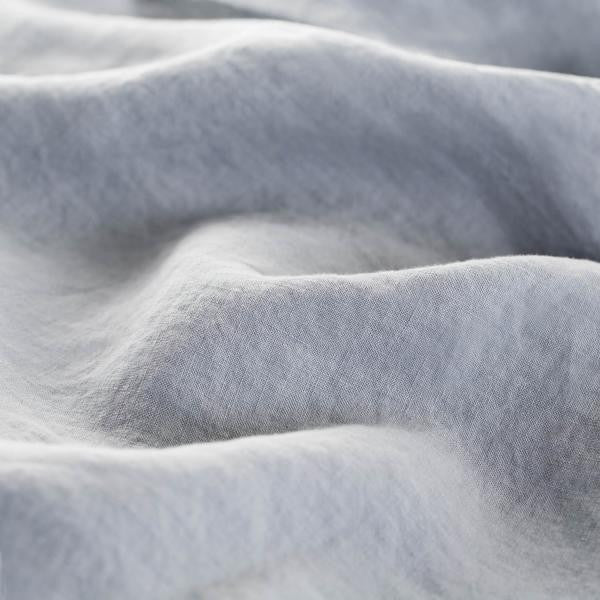 close up picture of a linen duvet to show it's texture