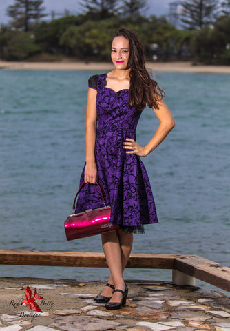 PURPLE FLOCKED EVENING SWING DRESS BY HEARTS & ROSES LONDON