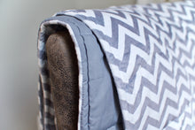 Weighted blanket shown in super soft, sensory-friendly minky with cotton on reverse side.