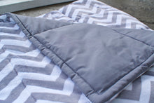 Weighted blanket with plush minky fabric on one side and cotton on the other side.