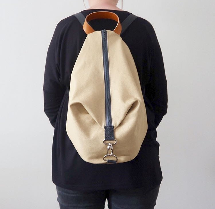 Knitters Carry All Backpack in Biscuit colour and being worn by Tracy thimble and thread make