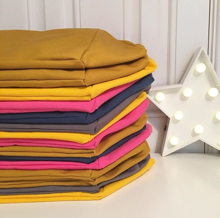 A pile of colourful Canvas Cube Bags, knitting project bag