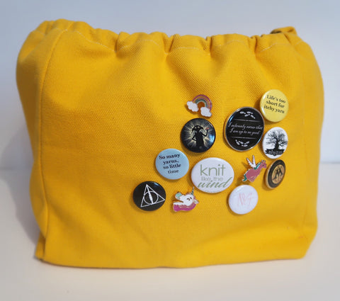 Canvas Cube Knitting Project Bag in Yellow Colour with pin badges added, large size for sweaters and granny blankets. Cube shaped drawstring bag