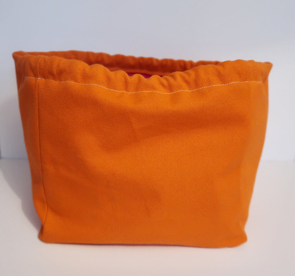 Canvas Cube Knitting Project Bag in Orange Colour, large size for sweaters and granny blankets. Cube shaped drawstring bag shown front on and standing upright