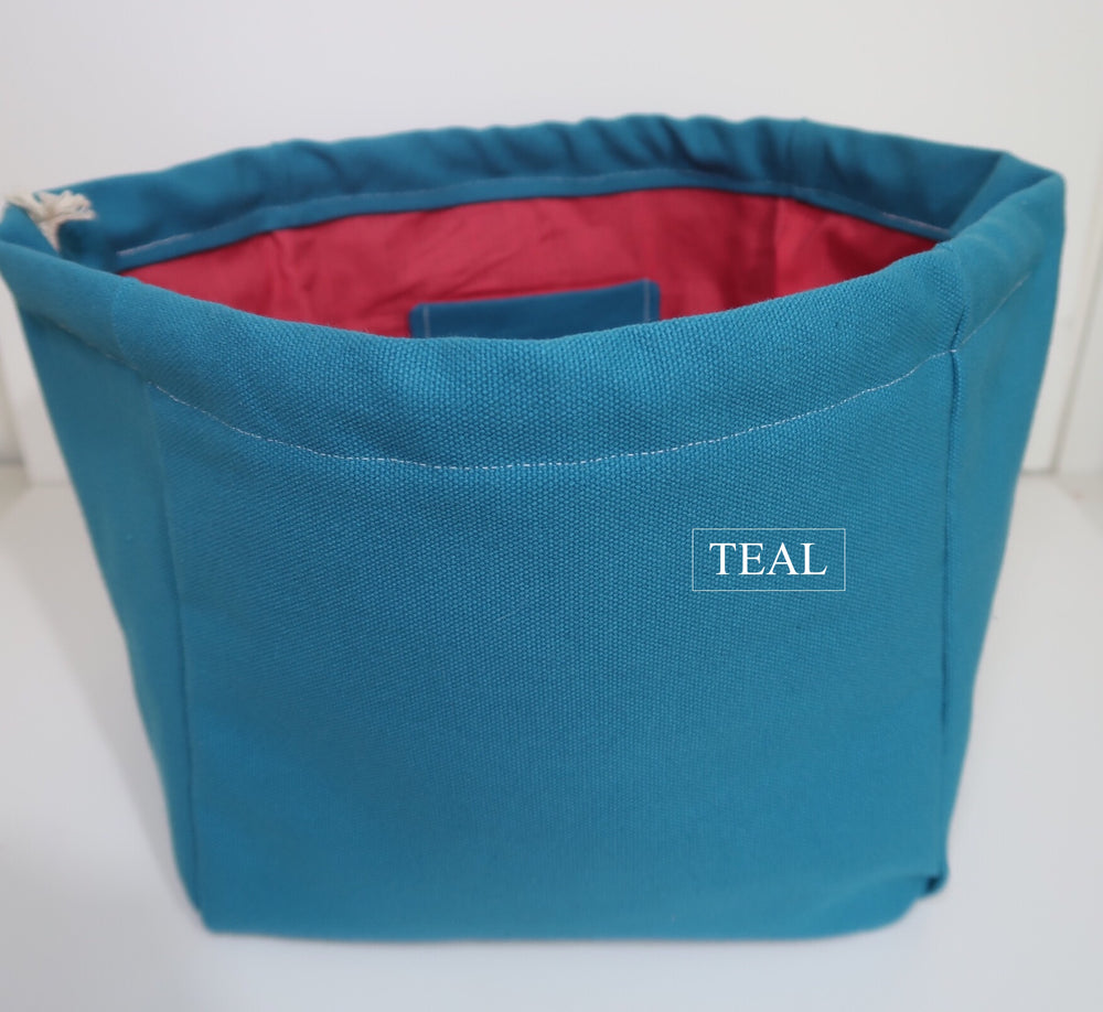 Canvas Cube Knitting Project Bag in Teal Colour, large size for sweaters and granny blankets. Cube shaped drawstring bag shown front on and standing upright