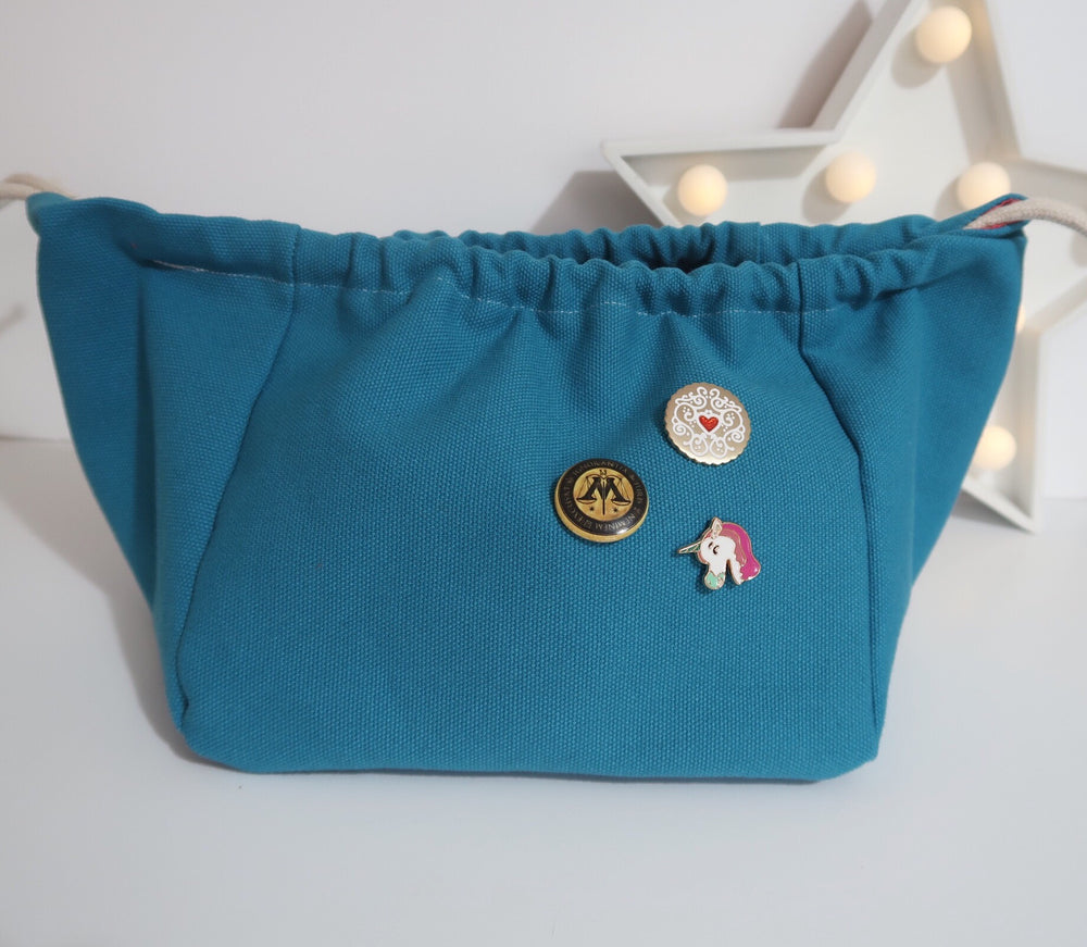 Knitting Project Bag small Canvas Cube Bag in Teal colour with badges added to the front and drawstring top closed