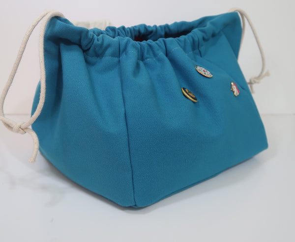 Side image for Canvas Cube Knitting Project Bag, large size for sweaters and granny blankets. Cube shaped drawstring bag, Teal coloured
