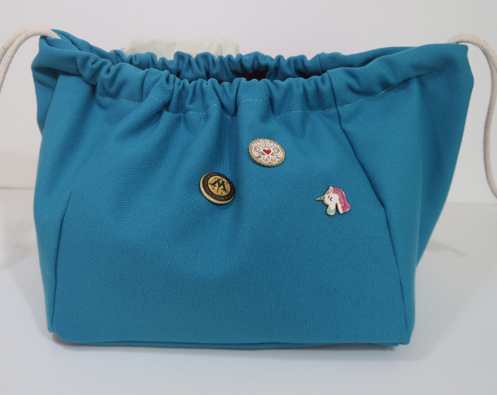 Canvas Cube Knitting Project Bag with pin badges added, large size for sweaters and granny blankets. Cube shaped drawstring bag, Teal coloured