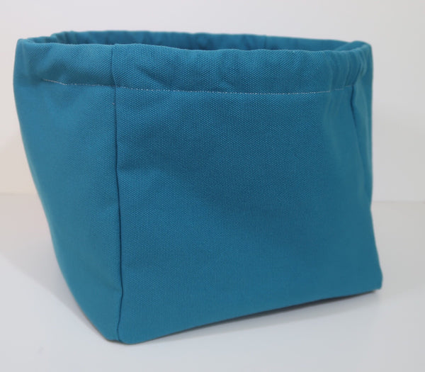 Canvas Cube Knitting Project Bag with Pockets, large size for sweaters and blankets. Cube shaped drawstring bag, Teal coloured showing the bag open and stood upright