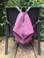 Knitting Project Bag ~ Knitters Carry All Backpack, front view of the bag hanging from a chair and shown in Purple colour