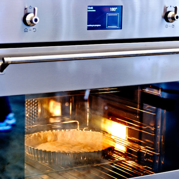 Why do you need to preheat your oven?