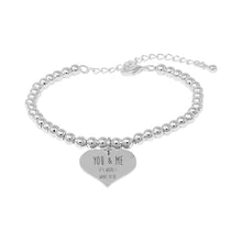 Silver Plated Adjustable Beaded Bracelet With An Engraved Heart Dangle Mounted On A Personalised You & Me It's Where I Want To Be Greeting Card