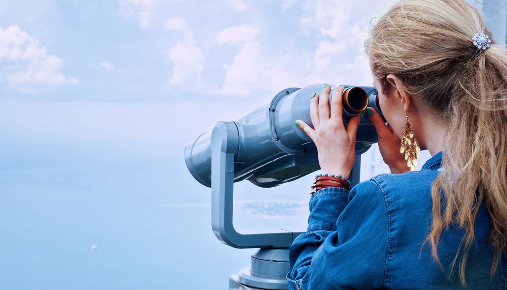 woman looking through telescope obsessor type end abuse