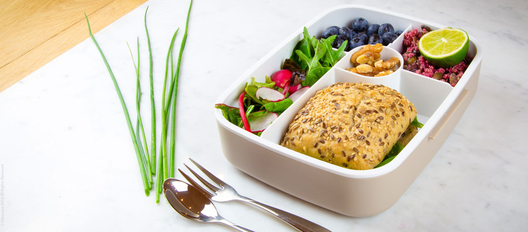 Gorgeous food photography: eSeasons Bento 5 compartment Lunchbox in Warm Grey with appetizing lunch of salad, blueberries, and sandwich