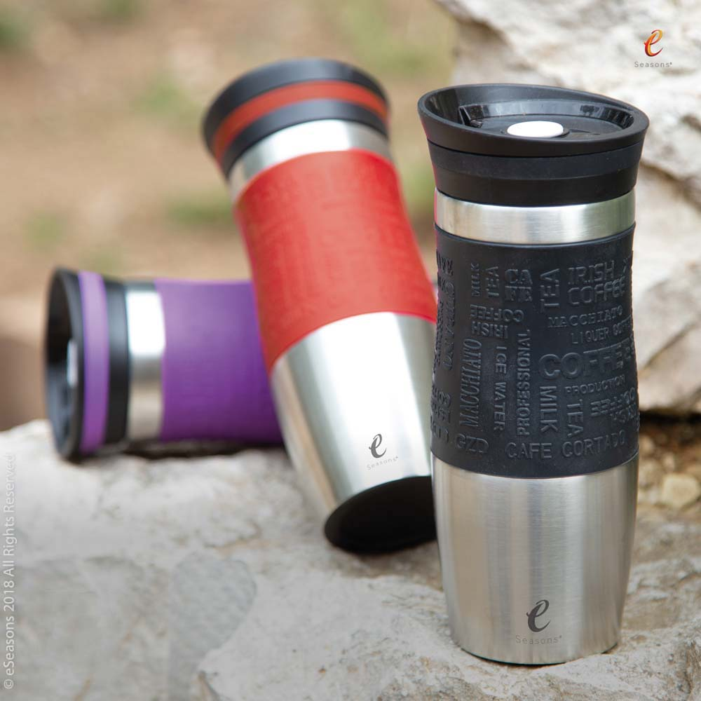 eSeasons Vacuum Insulated Travel Mug: hot coffee or tea, outdoors set against rugged quarried stone during hiking tour