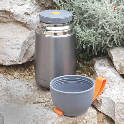 eSeasons Vacuum Insulated Stainless Steel Food Flask 630ml. Grey & Orange. Keeps hot/cold, expanded view stone backdrop from hiking trip