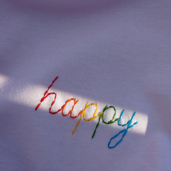 happy rainbow organic cotton white embroidered t-shirt