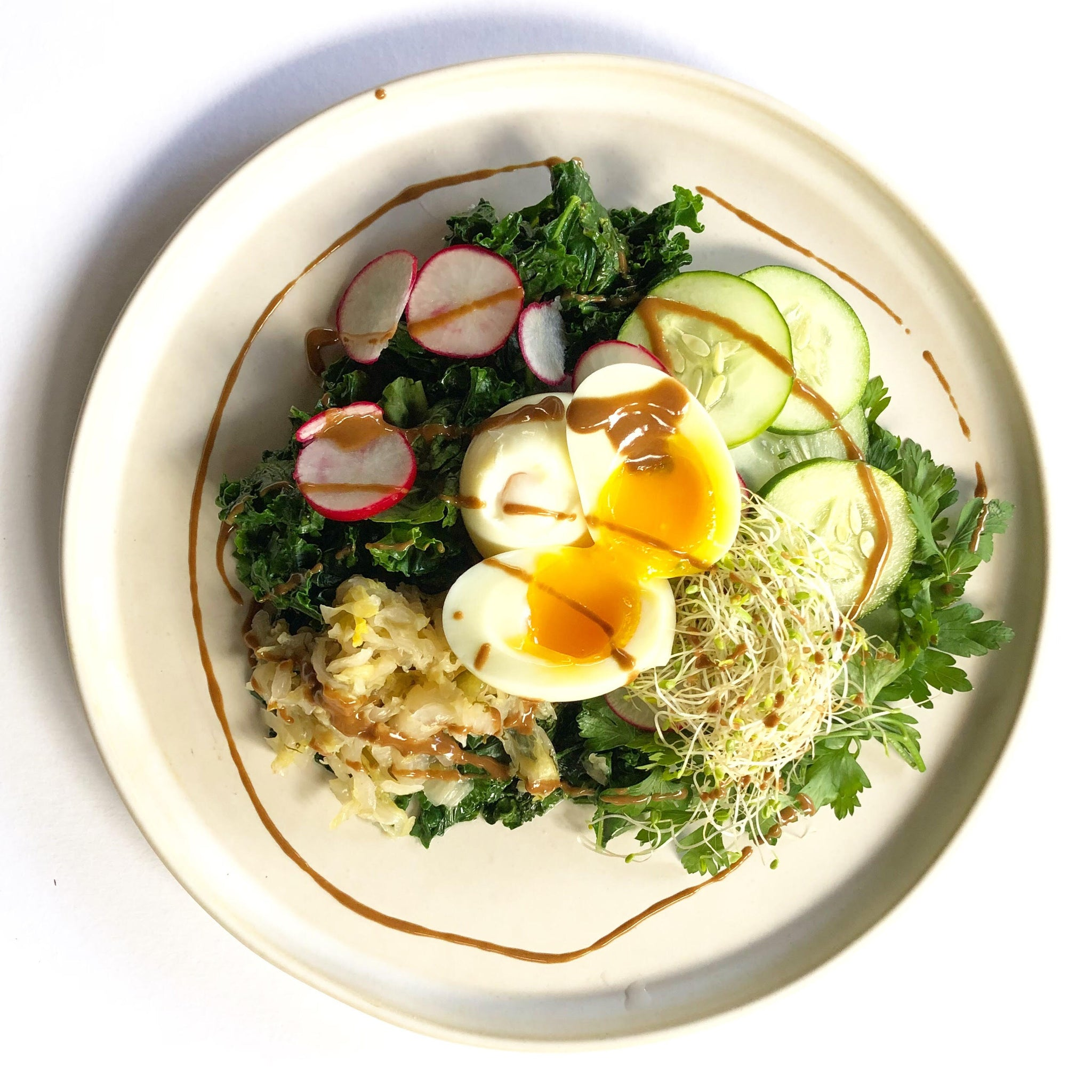 Coconut + butter kale with sauced and soft boiled eggs (Keto)