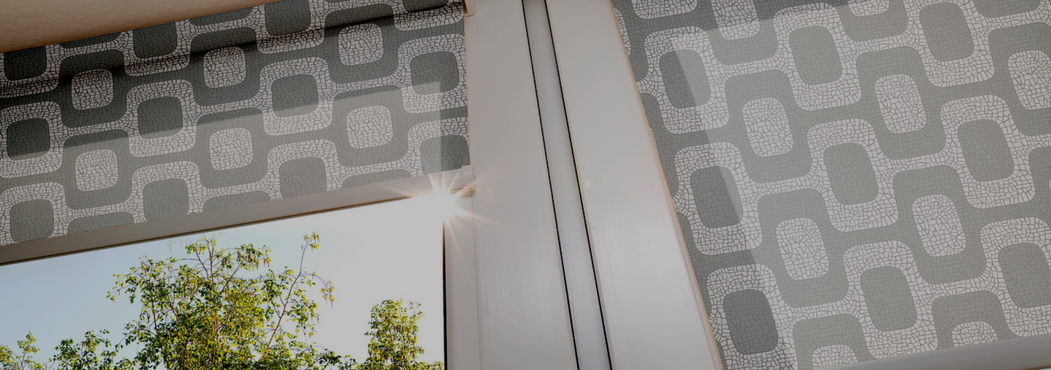 solar shades with a grey and white square design that is connected through lines