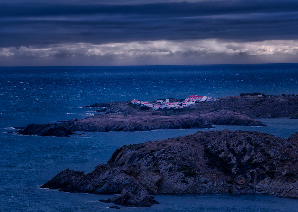 Thumbnail of a photographic scene of the ocean at night as a storm is brewing