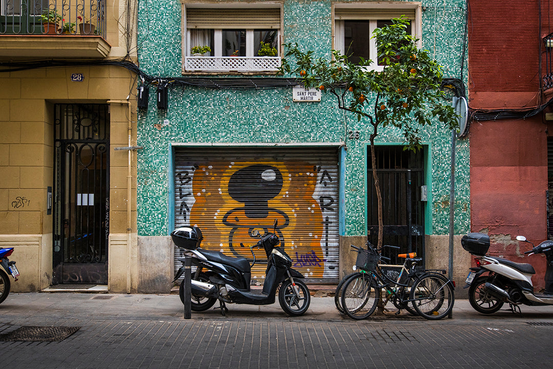Spanish street with mopeds and homes thumbnail