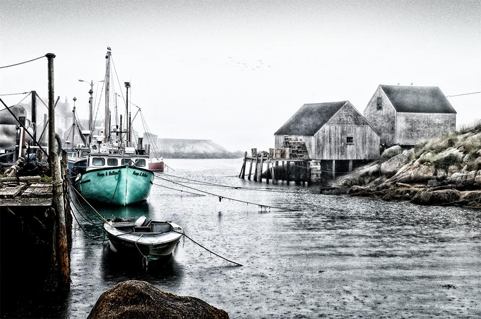 Black and white photographic mural of fishing and sail boat dock at the marina with a teal color focus on a single boat