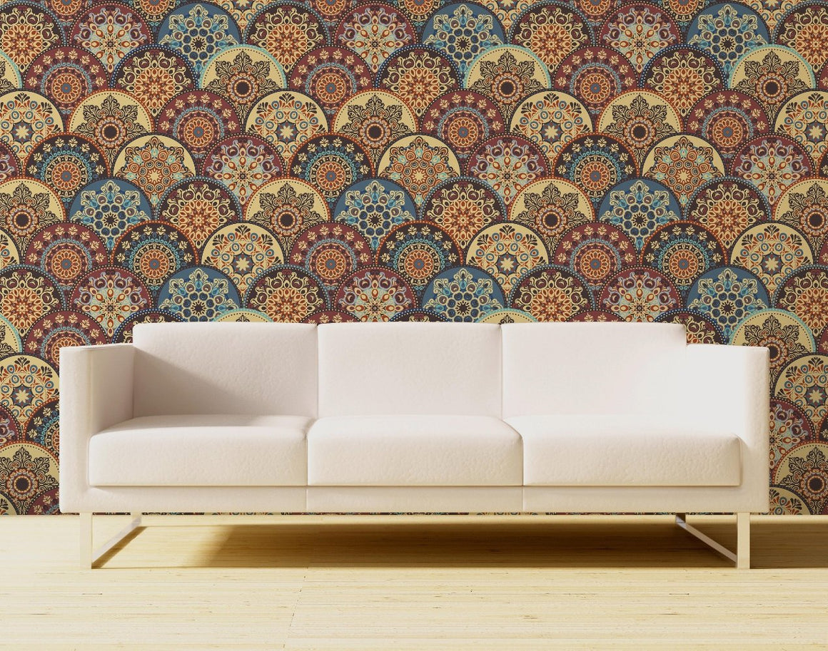Paisley designs in medallions in a scalloped pattern in various colors of red, yellow, brown and blue.