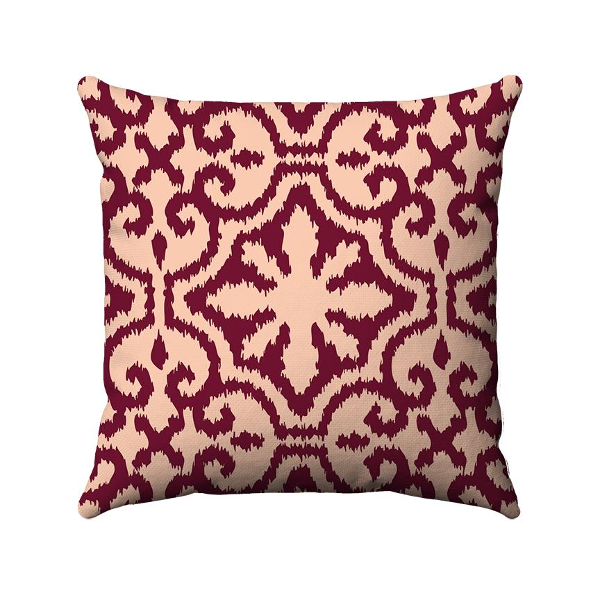 Red damask ikat design on a coral background.