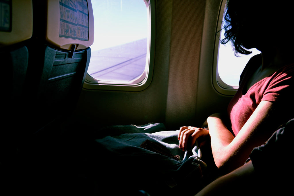 girl looking out the plane window