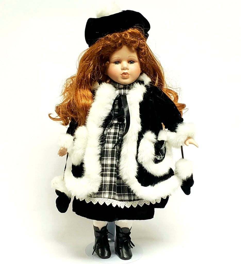 "Porcelain 17"" Doll, Long Reddish Hair Dressed in Black & White Winter Outfit"