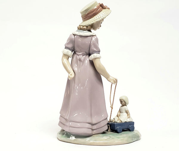 Girl With Toy Wagon, Retired Porcelain Figurine by Lladro 1978