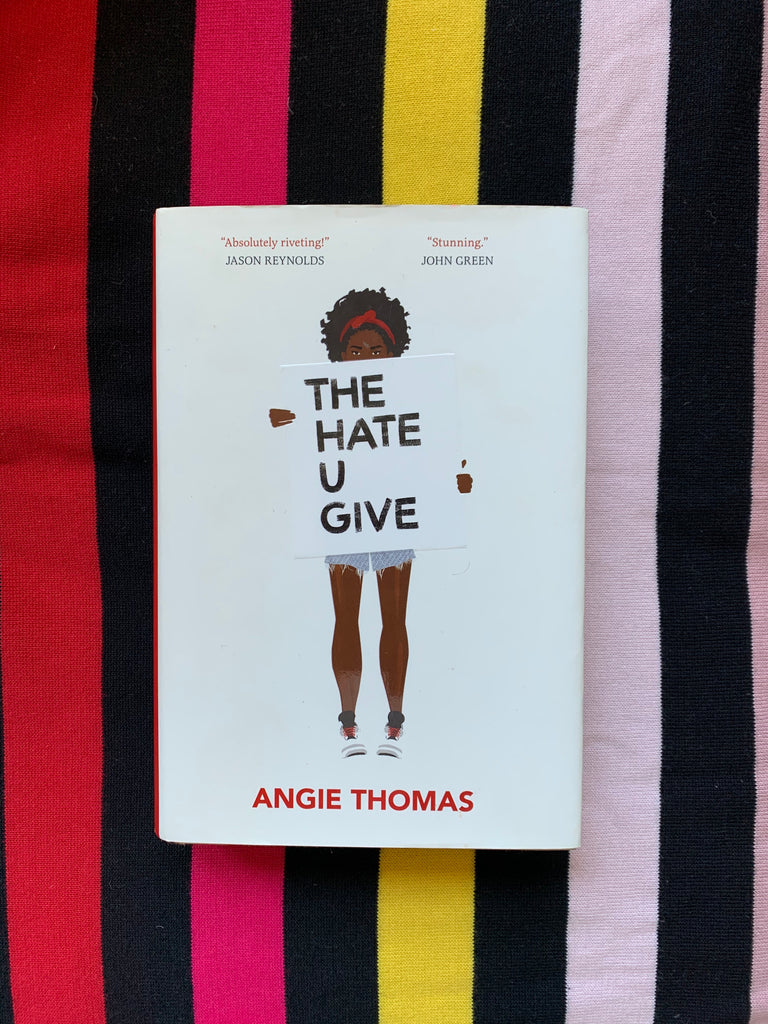 the hate you give by Angie Thomas book cover art rainbow stripes
