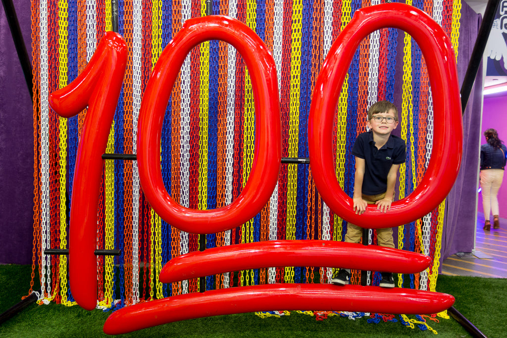 100 sign at candytopia