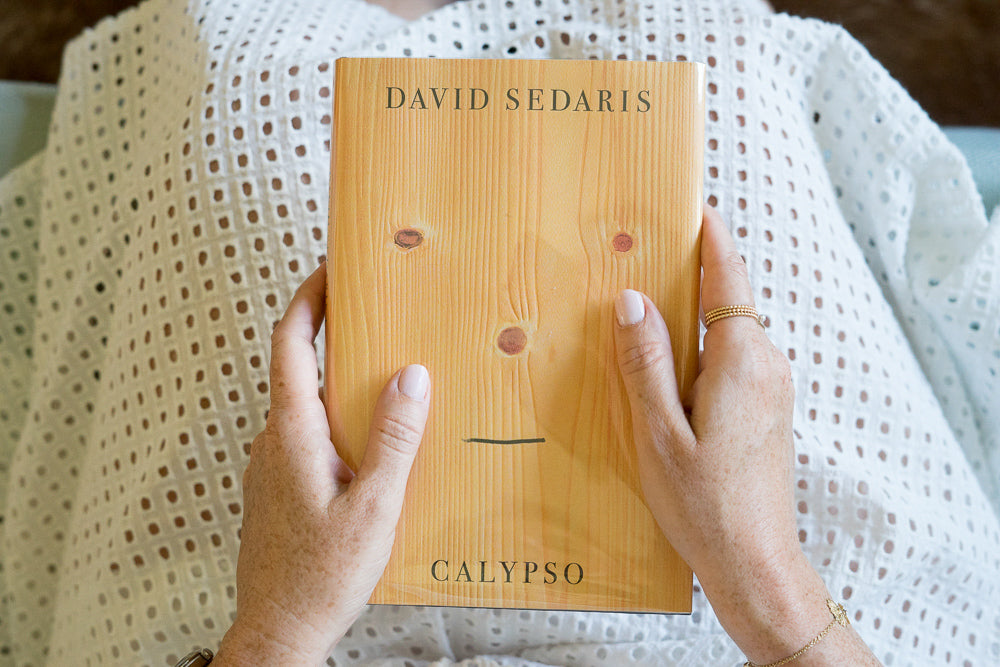 David seders calypso book with hands and white skirt