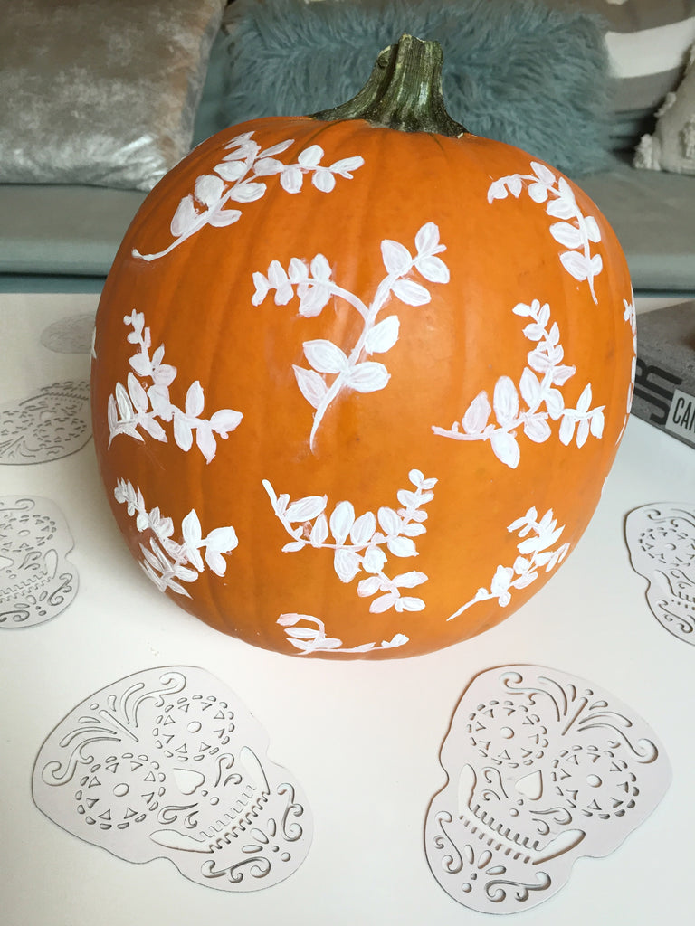 painted halloween pumpkin with leaf pattern