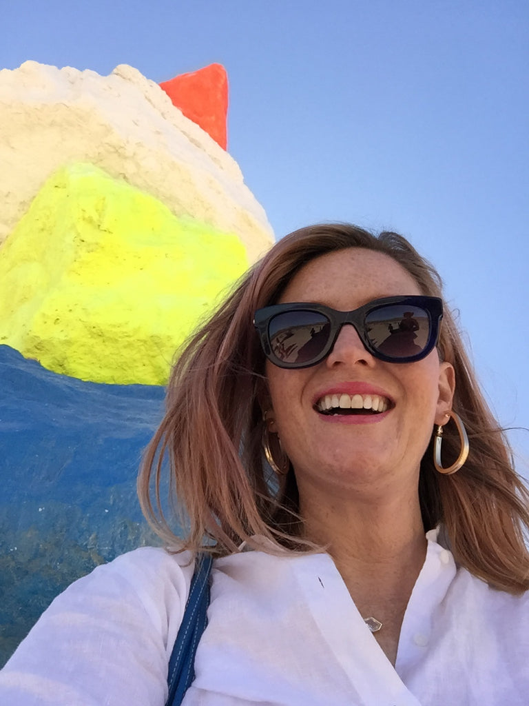 janna Conner at seven magic mountains smiling laughing with neon art