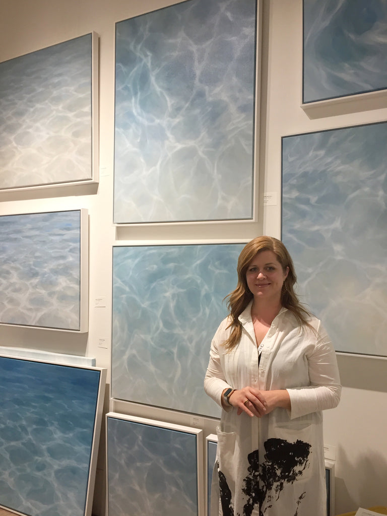 Laura Browning artist standing with water paintings at the Other art fair at the majestic downtown LA