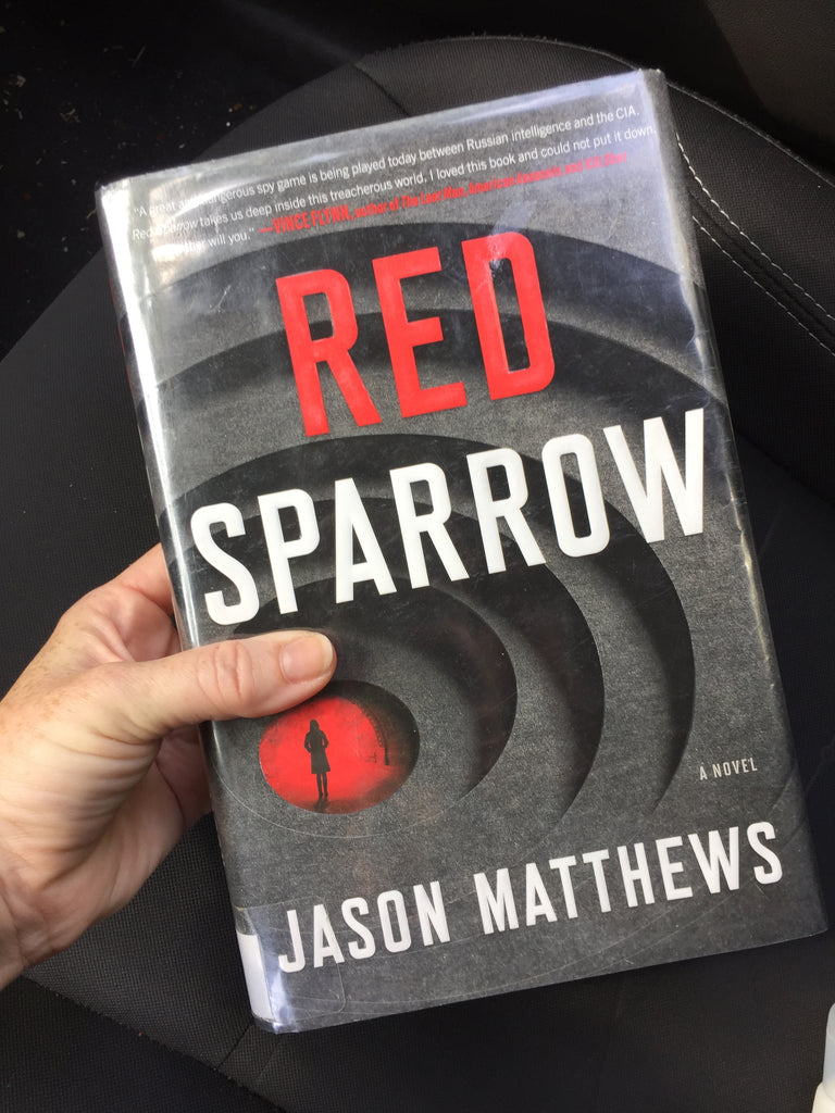 hand holding red sparrow book