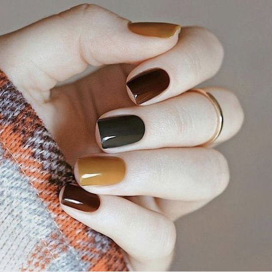 multi color fall manicure on hand