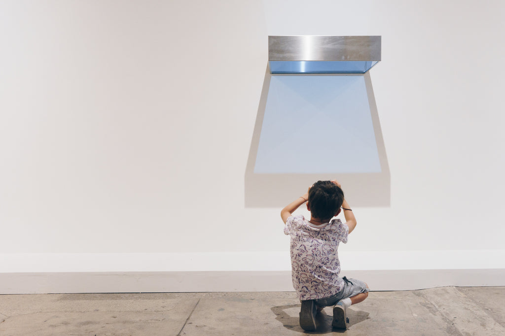 child taking photograph of Donald Judd artwork at Underground Museum LA