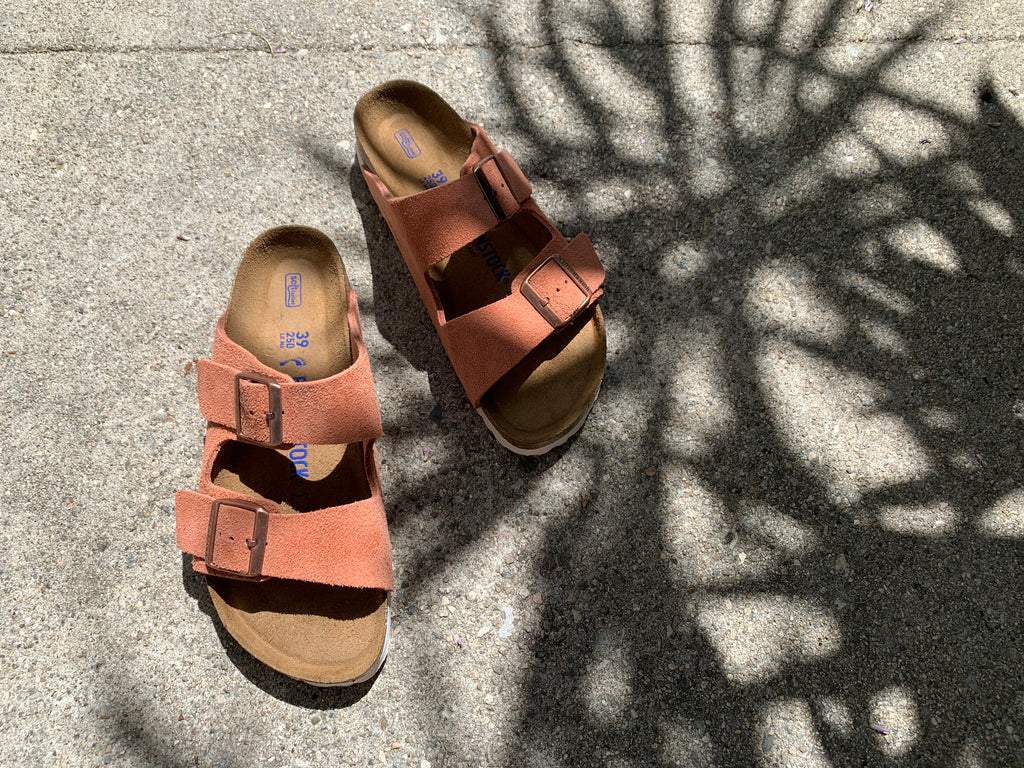 pink suede Birkenstocks with palm tree shadows