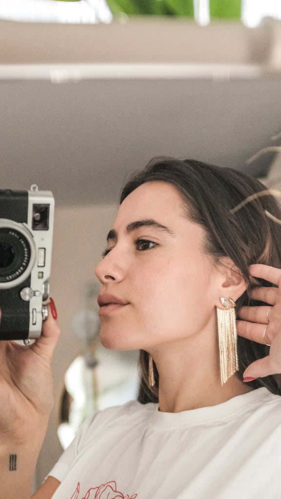 marquis fringe earrings on girl holding camera selfie