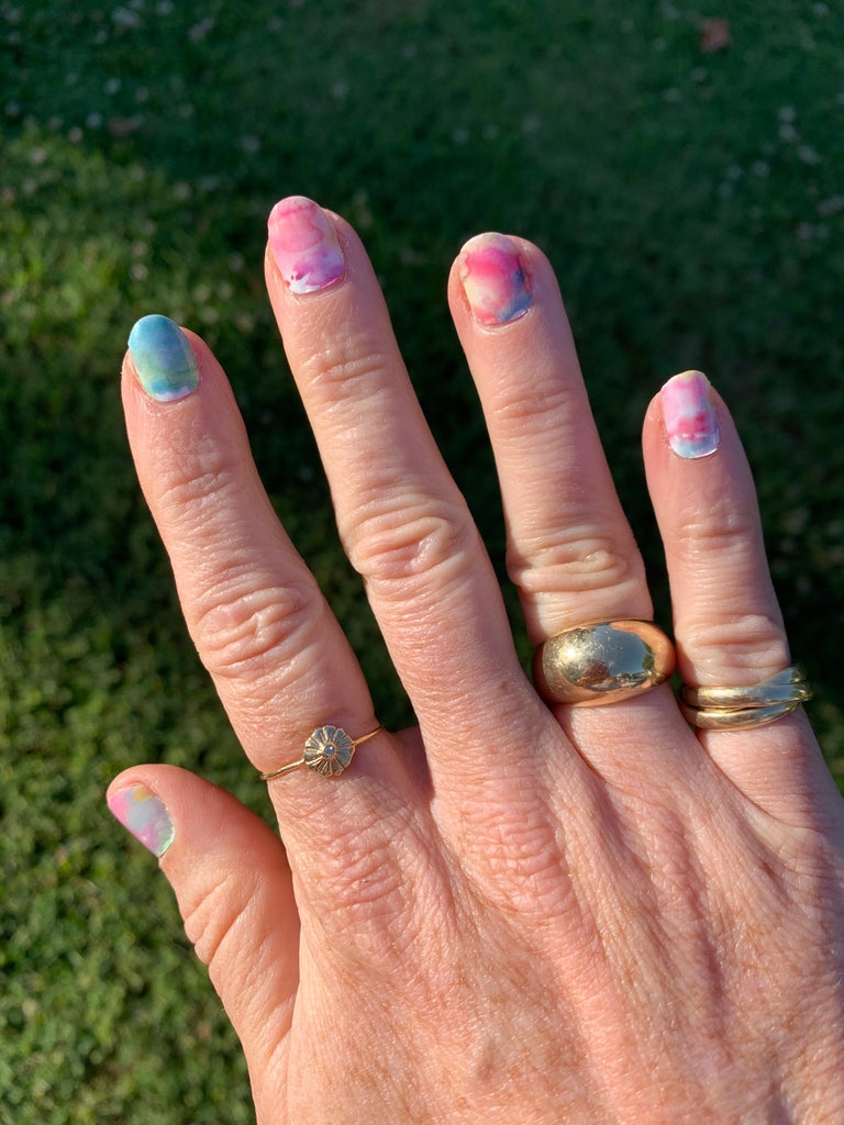 Janna Conner watercolor nail art stickers and gold stacking rings