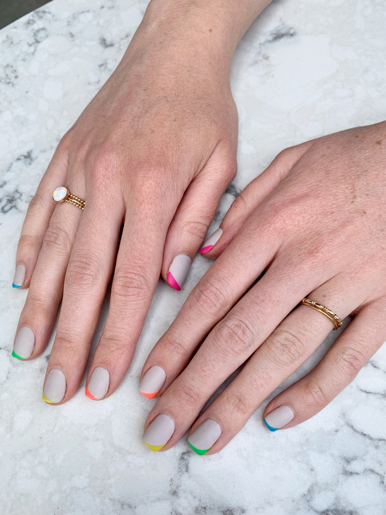 matte rainbow nail art and Janna Conner rings